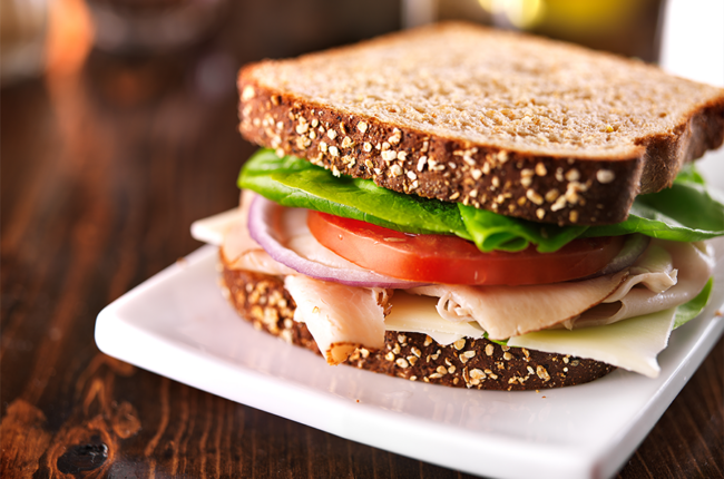 Cold cut turkey sandwich on whole wheat with swiss cheese