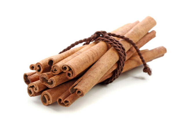 Cinnamon sticks tied together in a bunch