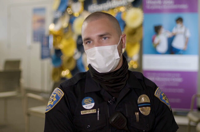 School Police Officer getting vaccinated