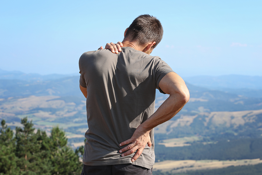 Man hiker with back pain