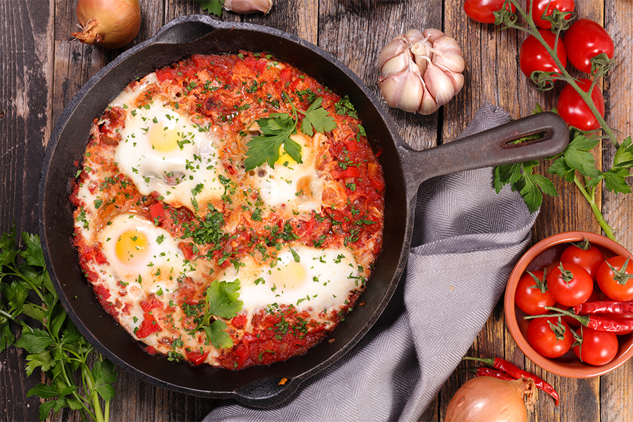 Cast iron skillet with tomatoes and eggs