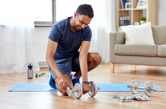 Indian man with weights set at home