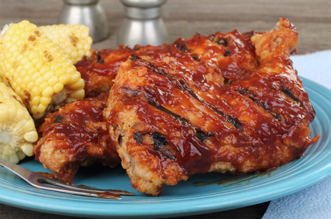 BBQ Chicken on a plate with corn on the cob