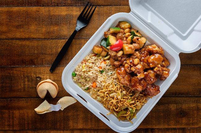 Chinese food take out, rice, orange chicken, veggies and noodles