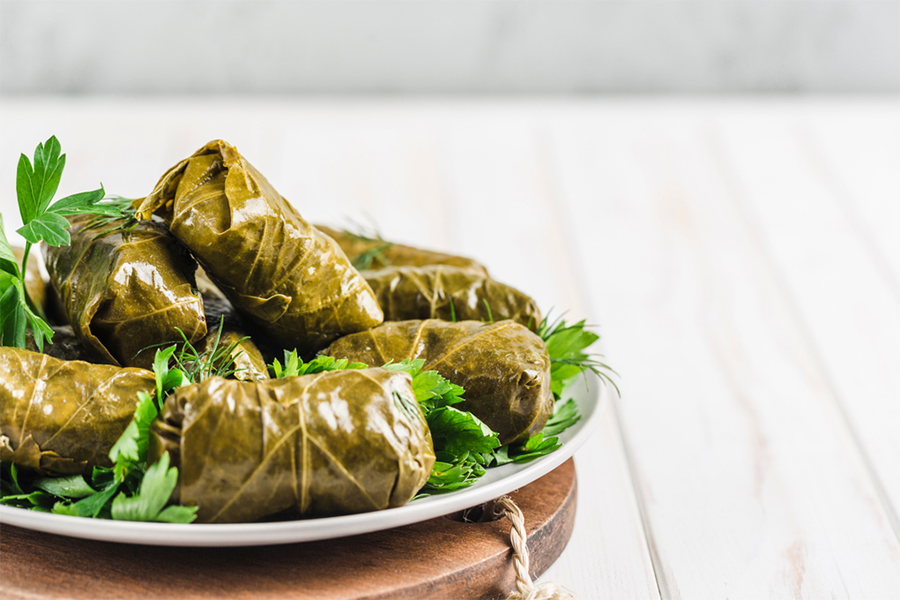 Rice wrapped in Grape Leaves on a plate