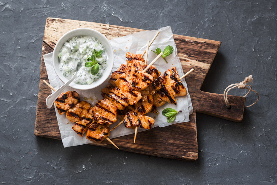 Oregano and Garlic Chicken Skewers with a bowl of Tzatziki Sauce