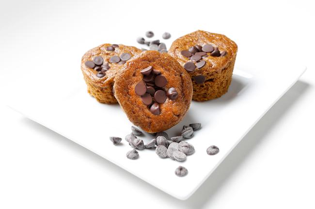 3 pumpkin chocolate chip muffins on a plate